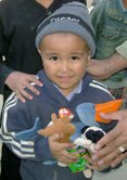Smiling child with his new Beanie Babies.